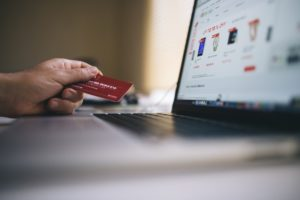 Woman buying something online with card