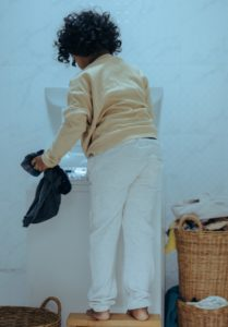 Child doing clothes washing