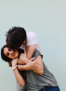 teenage couple hugging